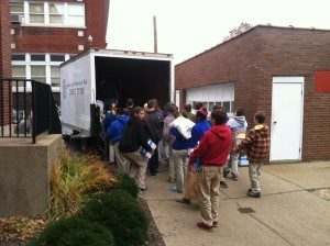 Students at St. Benedict School loading the SVDP Thrift Store van.